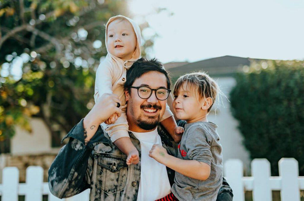 man carrying children